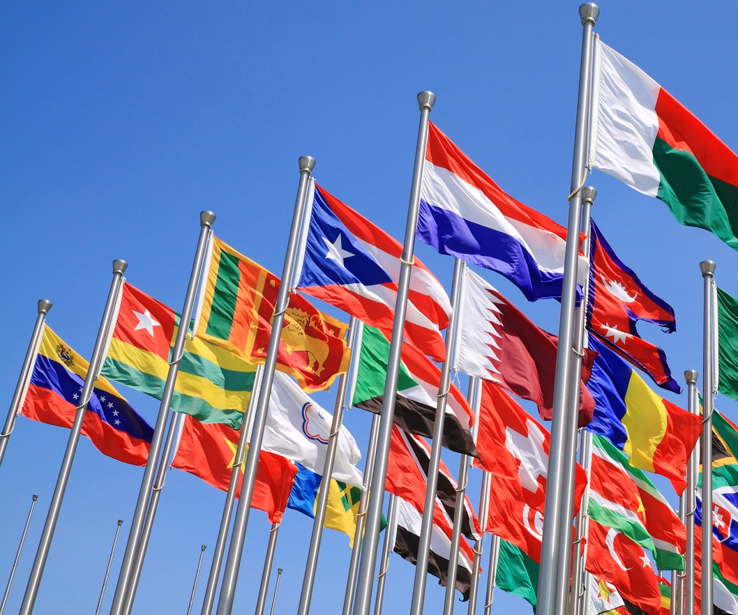World-flags-on-poles-waving-in-the-sky-134021043_1060x990.jpeg
