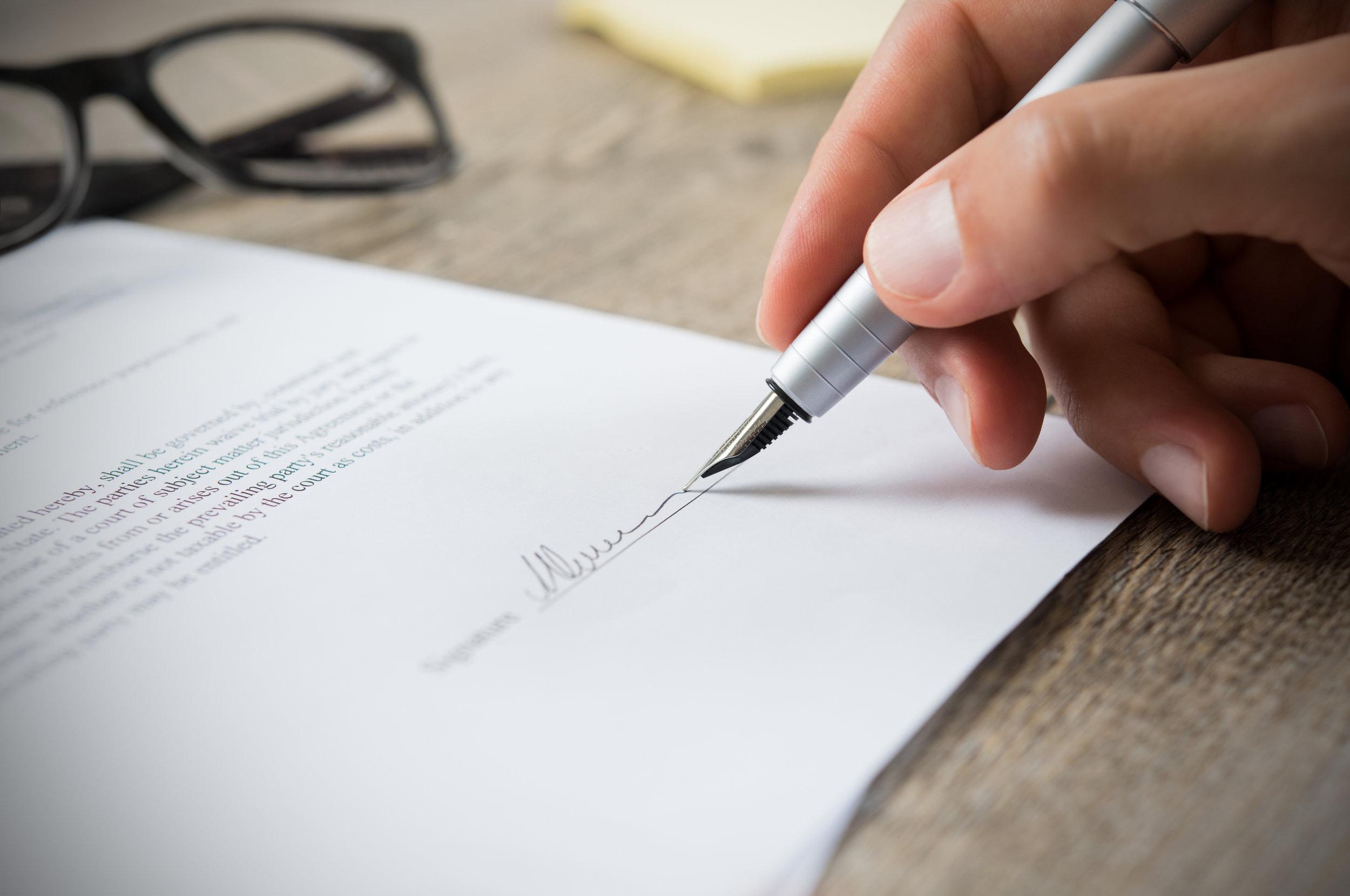 Man-signing-contract-615419978_3875x2573.jpeg