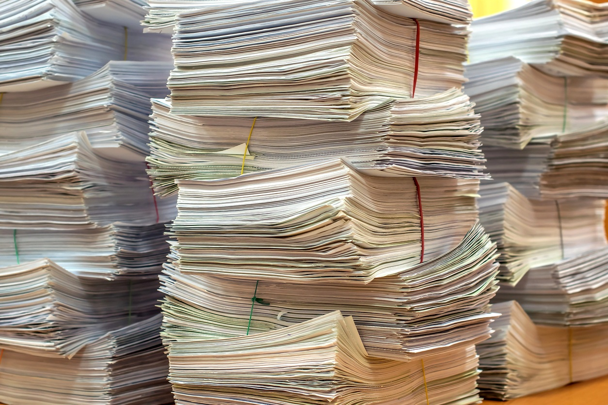 pile-of-paper-documents-in-the-office-928605524_1257x838.jpeg