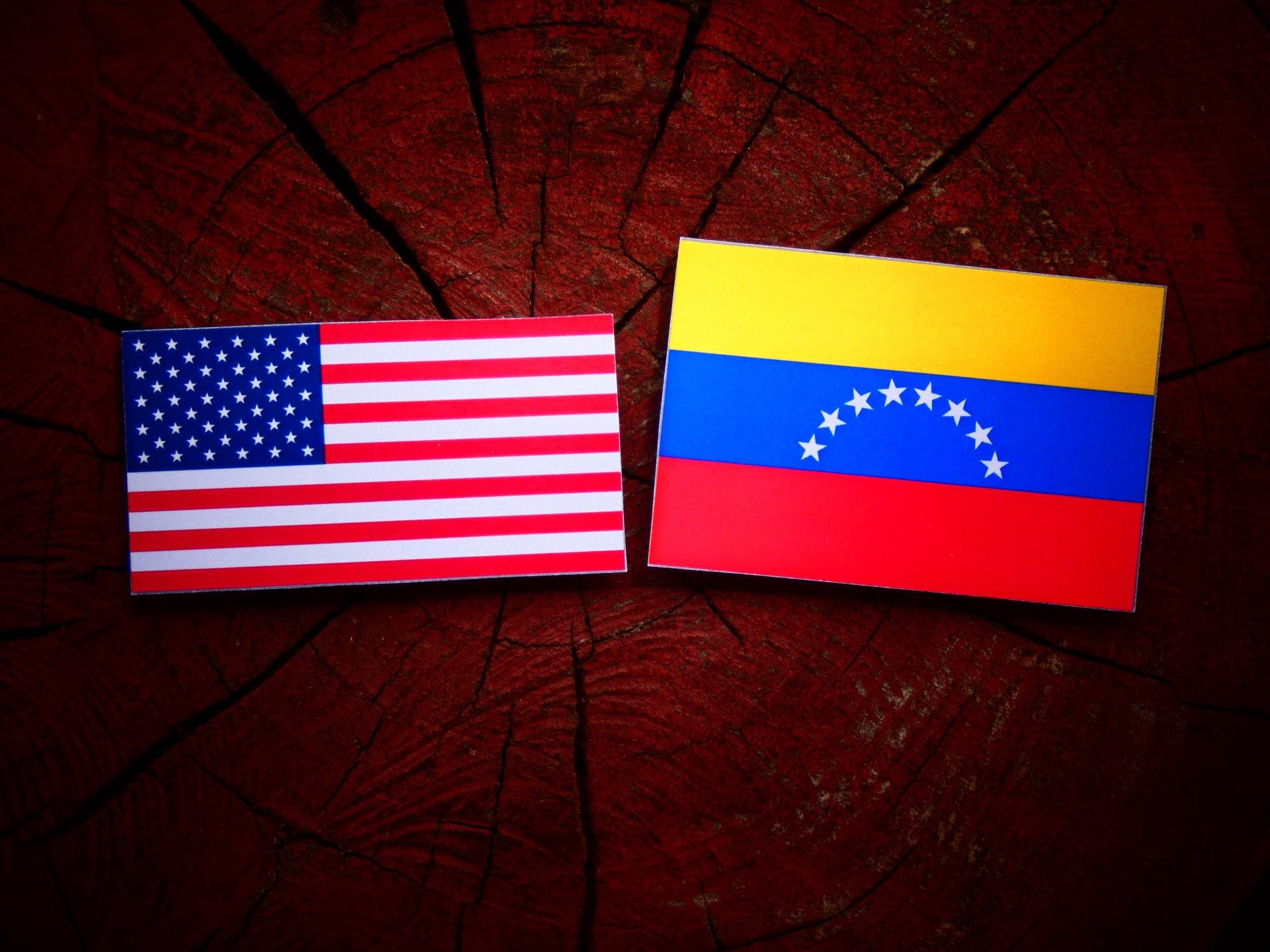 USA-flag-with-Venezuelan-flag-on-a-tree-stump-isolated-823303598_2003x1502.jpeg