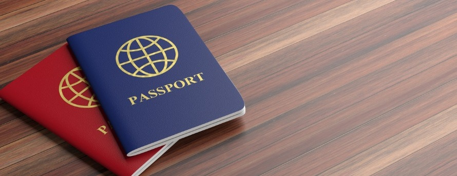blue-and-red-passports-isolated-on-wooden-background-banner-copy-3d-picture-id1035632160.jpg
