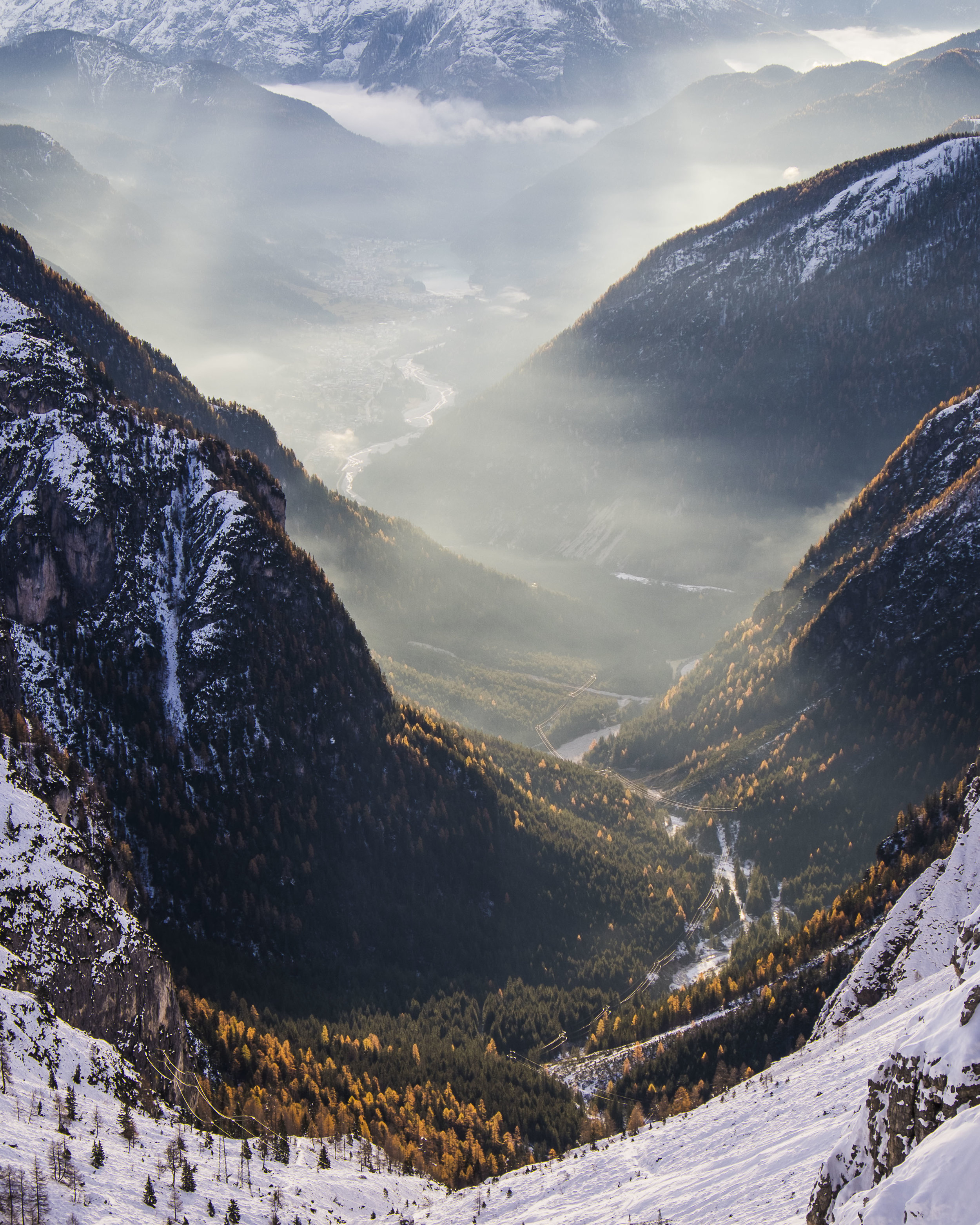 2000m  After hiking up in total darkness and deep snow I got rewarded by these stunning sunrays in the valley below after sunset. 55mm, f9, 1/90s, Fuji X-T1
