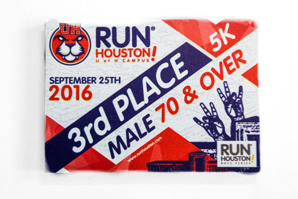 2016 Run Houston! UH age group award printed on MDO.