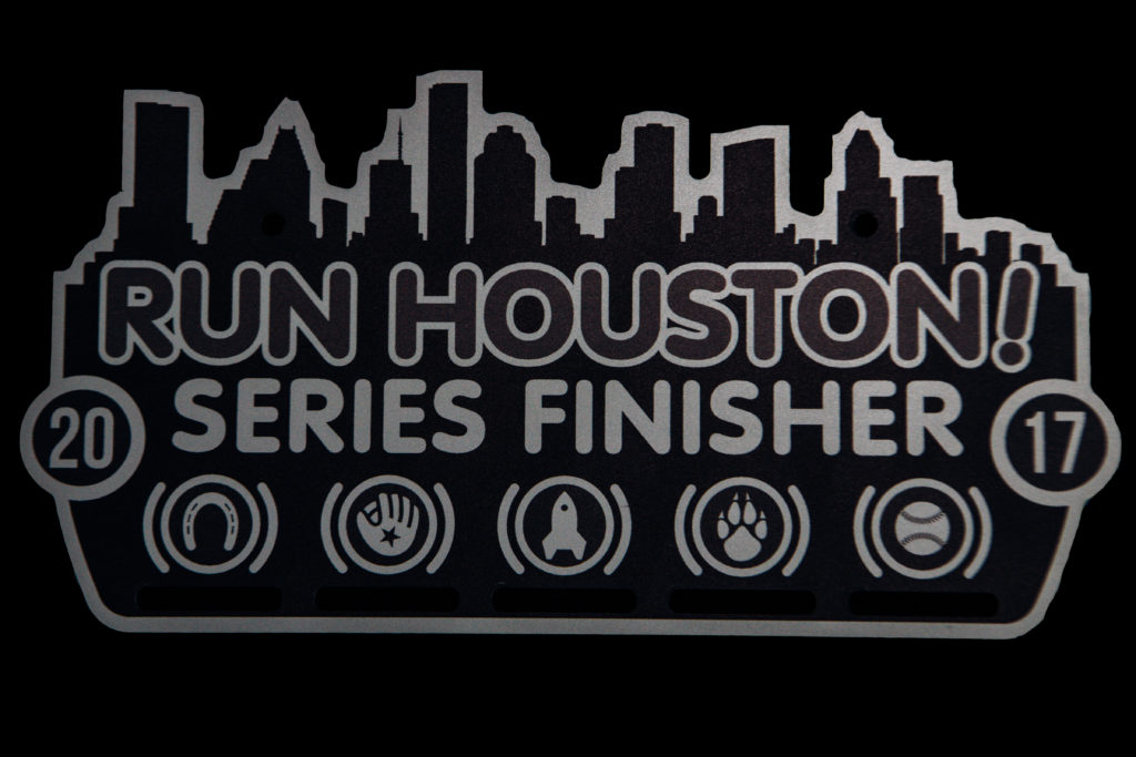 2017 Run Houston! Race Series Finisher item given to those that completed all five races in the Series. Printed on aluminum.