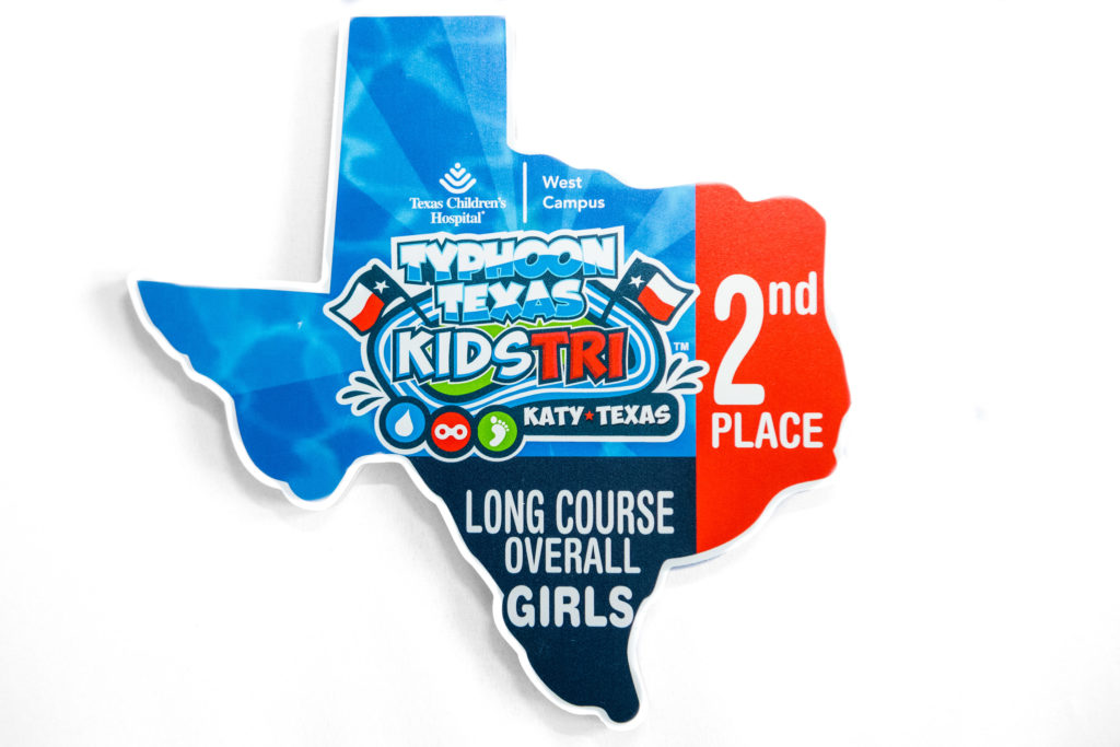 2016 Typhoon Texas Kids Tri age group awards. MDO in the shape of Texas.
