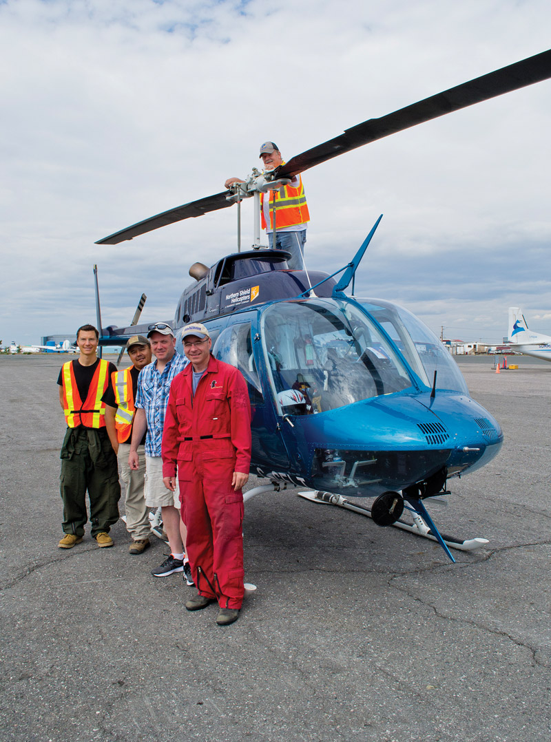 Spending six hour days in the air, helicopter survey crews recorded data. ©DUC