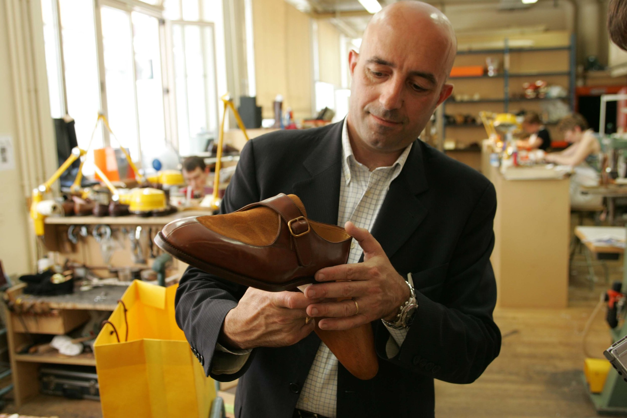 Philippe Atienza – who was, at the time, head of the Hermès-owned John Lobb Paris bespoke operations – inspecting David Dowsey's bespoke shoes in the Paris workshop in which they were made. Photo by David Wright from   A Le Mans Diary  .