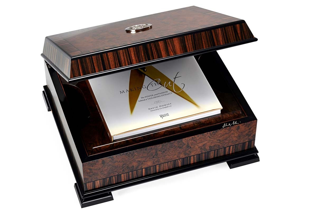 The exquisite  Boucher & Co  Macassar and ebony presentation box custom-made for   Making the Cut: The Power and Passion behind a Tailoring Dynasty  . Photo by  Richard Weinstein .