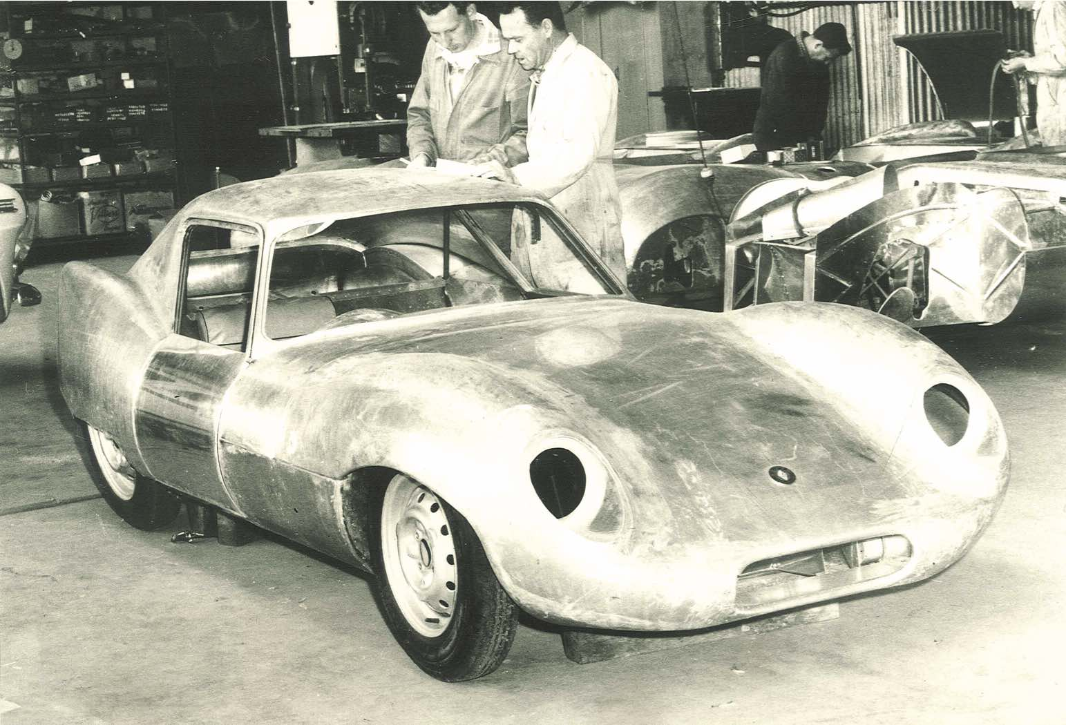 Garrie Cooper and body-maker John Webb inspect progress of the Elfin GTS Coupe
