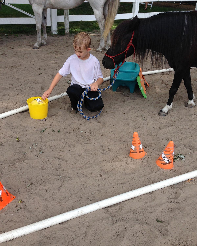 yellow-bucket-boy-pony-reading-river.jpg