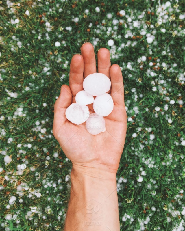stock-photo-ice-weather-holding-storm-hand-hail-hailstorm-08b6eaa4-68c5-4330-ad5a-0e845e882bc9.jpg