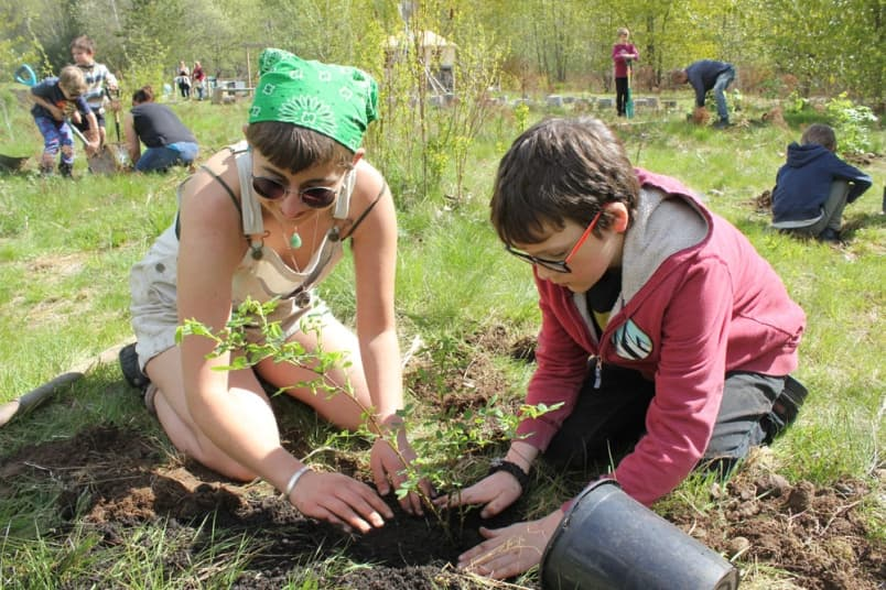 Katie Hargus planting native species with youth in Squamish, BC.