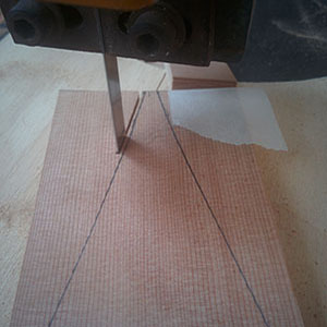 16. The 12 rib-blanks have been taped together then cut on a bandsaw. Cut about 1mm outside the line