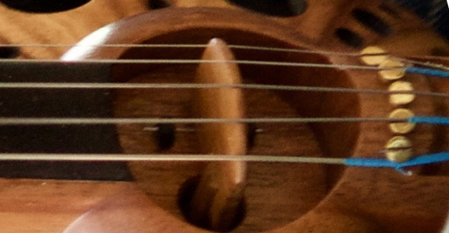 Note that both 1st string and 5th string have been hooked under the screw to increase string angle