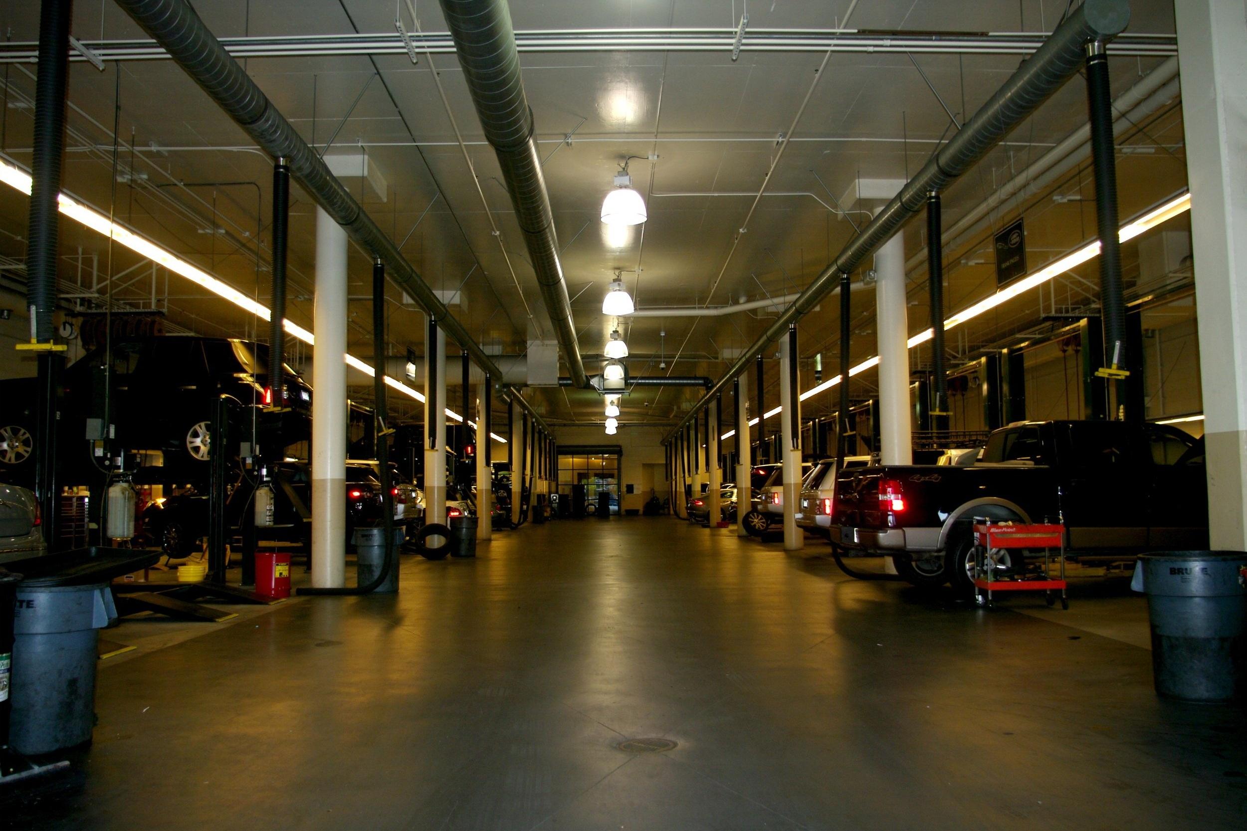BEFORE – Lighting in car repair bays at dealer.
