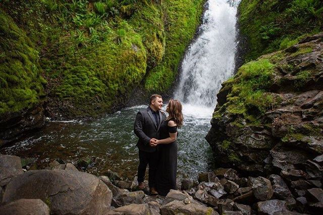 True magic is hiking up your dress and carefully stepping down a path lined with boulders and moss, holding hands with your partner as he hikes beside you in a suit and tie, then smiling a gorgeous smile as you realize that the rest of your lives will look just as amazing as this moment. ' ' ' ' ' ' '#fallinginlove #wanderingphotographers #engagementphotos #oregonengagement #exploregon #columbiarivergorge #bridalveilfalls #crazyloveandwildkisses #peoplewhohike