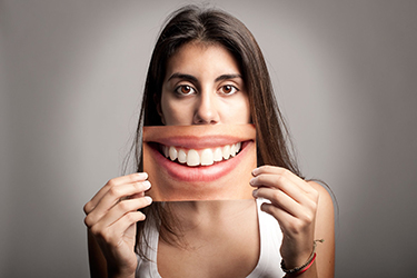 When you're happy with the appearance of your teeth, you smile more.