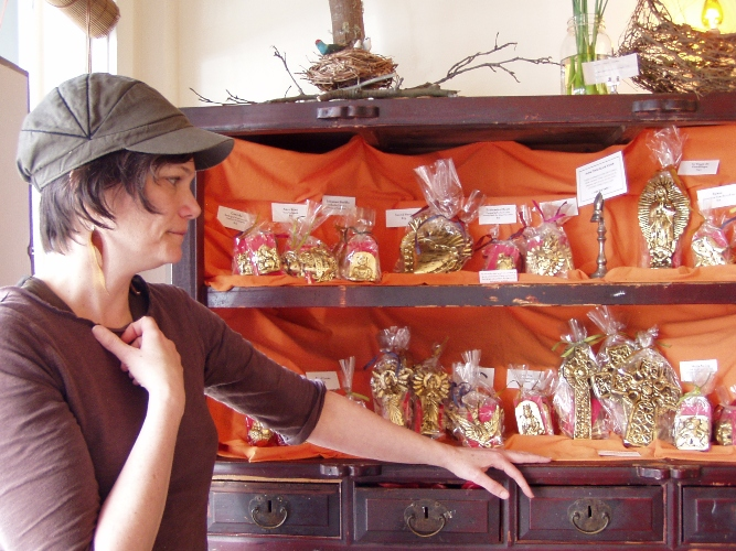 Alma Chocolate owner Sarah Hart communing with her gold leaf gilded chocolate icons