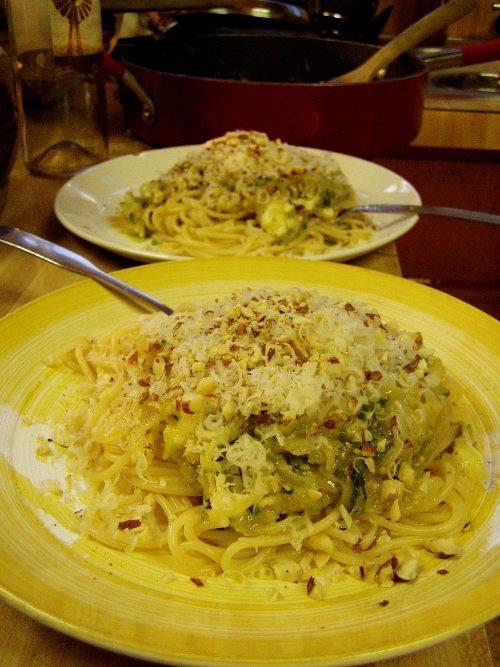 Caramelized onion spaghetti with roasted hazelnuts, arugula and feta