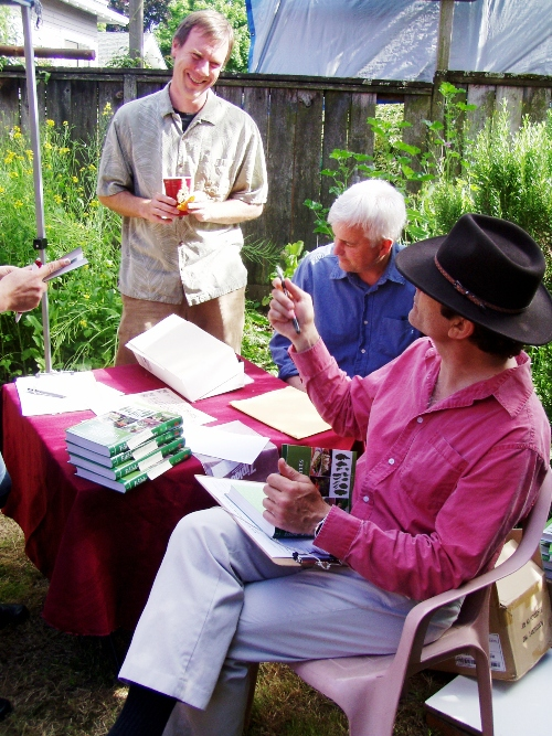 John Kallas signing books at his book launch party for Edible Wild Plants.