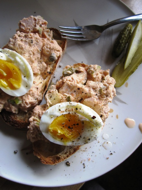 Red curry tuna salad with medium boiled eggs and homemade spicy garlic dills.