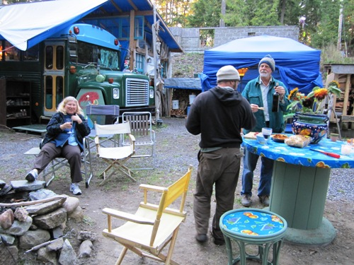 We cooked the potatoes and corn on the fire in the foreground and everything else in the outdoor kitchen behind the bus.