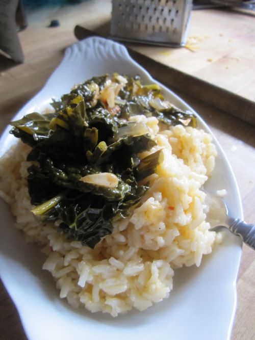 A simple dinner of sauteed kale with a little pickle juice and cheesy rice.