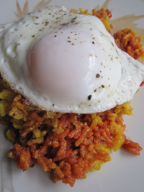 Leftover turmeric rice with chicken reduction and basted egg.