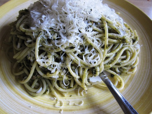 Pesto and tapenade spaghetti topped with parm.