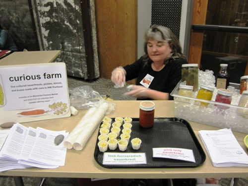 Curious Farm's Cathy Smith serving up leek horseradish kraut, fermented chili sauce and more.