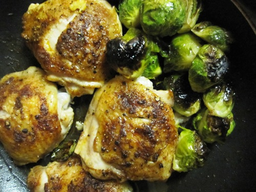 Roasted chicken thighs seasoned with smoky paprika, salt and pepper and brussels roasted in the pan juices. Quick. easy and super good.