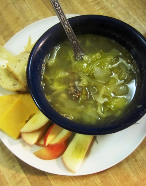 Cabbage sausage soup with a few other bites on the side.