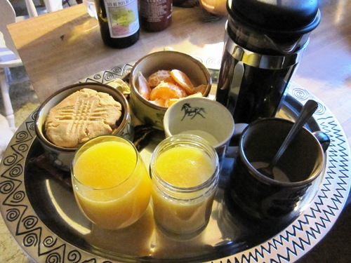 Breakfast in bed with those PB cookies, tangerine and coffee and orange juice.