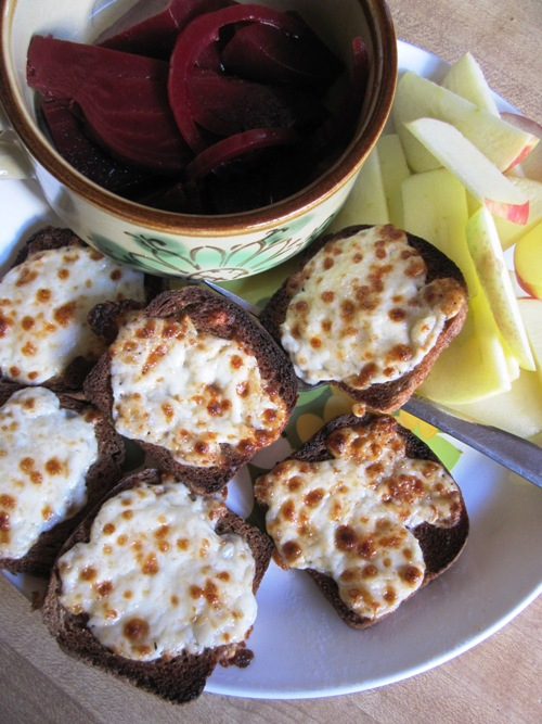 We make this sort of a snack platter a lot in the winter -- cheese breads with grated onion, homemade pickled beets and honeycrisp apple.