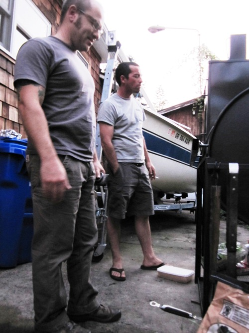 Dave and Tyler doing what smoking meat requires -- a lot of waiting...