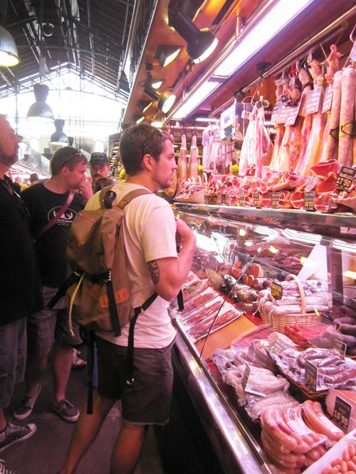 Inside! So many raw and cured meat stalls. And everything else that is Spanish and delicious...
