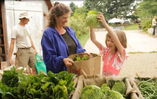 SNAP recipient Jennifer Dynes and her daughter, Annie, picking up their Zenger Farm Share. Photo courtesy of Zenger Farm.