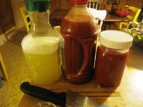 Late night camping trip bar prep of gingery Bloody Mary mix and margarita mix made with two bags of limes.