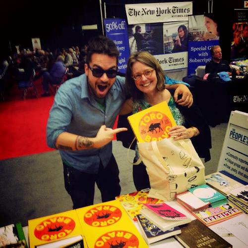 Our McSweeney's publicist extraordinaire Isaac Fitzgerald pimping the book at the McSweeney's booth at Wordstock.