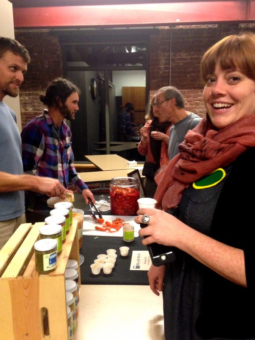 My friend Kelli Brandt in the foreground trying Colin Franger in the background's Blue Bus Cultured Foods super tasty Shakedown Beet and Kraut-chi.