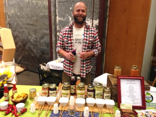 """Brian Shaw of Oregon Brineworks serving up the wild and beautiful array of super tasty ferments that he and Connie always bring to the festival. I helped at his table a bit under the guise of """"helping"""" -- really I just wanted to be closer to all of those yummy samples ;)"""