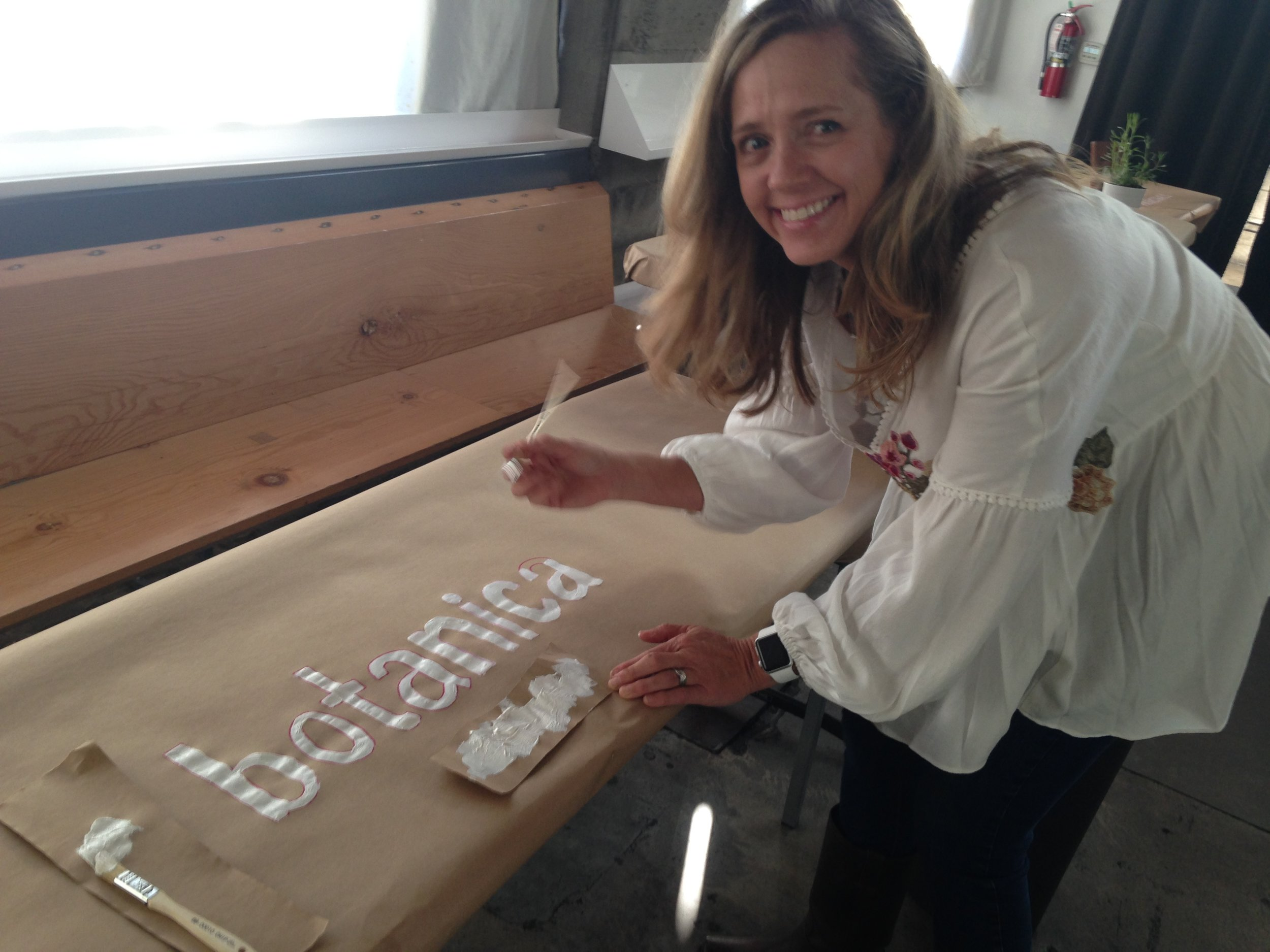 Amy Risch, founder and CEO of  Hana Medicinals , helping Seattle's  Botanica  with their table. Everyone helped everyone. Super sweet and fun party set up at Holocene.