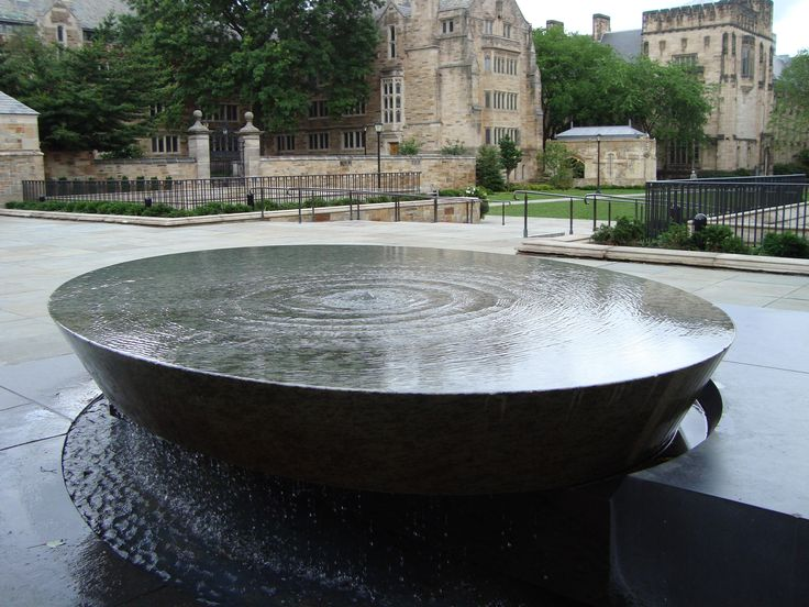 """The Woman's Table,"" by Maya Lin (BA 1981, M.Arch 1986), is a monument outside Sterling Library that commemorates the presence of women at Yale University."
