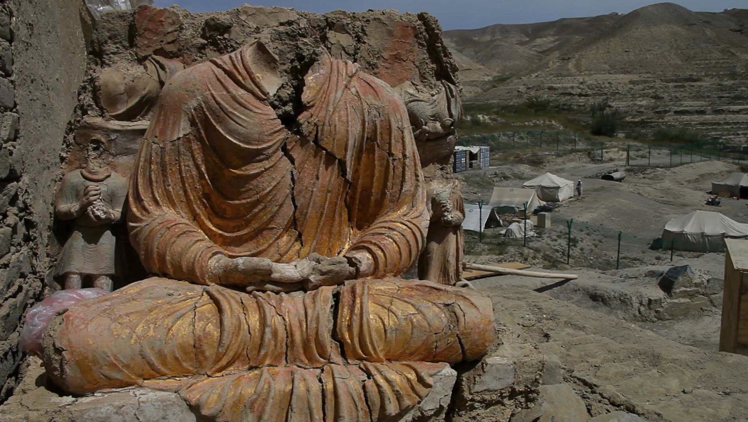 """Afghan Archaeologists Risk Lives to Save Ancient Buddhist City - Mes Aynak is a site 40 km southeast of Kabul, which contains Afghanistan's largest copper deposit. It also houses the remains of an ancient buddhist settlement with over 400 Buddha statues, stupas and a100 acre monastery complex.In 2007, a 30-year lease was granted to a mining company. The ancient Buddhist ruins, along with irreplaceable historical treasures, were scheduled to be destroyed. Racing against time, and against the threats of taliban abductions, landmines, and insurgents from Pakistan, Afghan archaeologists risk their lives daily to preserve and uncover the priceless cultural heritage of the ancient Buddhist city before it is obliterated by mining operations.Courageous story told in documentary """"Saving Mes Aynak,"""" a documentary directed by Brent Huffman, tells the story through of lens of Qadir Temori, the head of the Afghan archaeological department in Kabul.Huffman explains that Temori is """"braving all of this risk and being very courageous, going against the Taliban, going against this Chinese mining company, going against the bureaucracy in the country to try to save essentially the cultural heritage of Afghanistan... The heart of the fllm is really this story of Afghan archaeologists risking their lives'"""