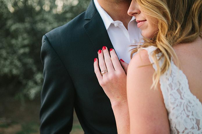 Anza-valley-wedding-at-the-alpaca-farm-bride-and-groom-close-up-brides-hand-with-wedding-ring.jpg