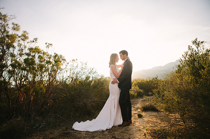 Anza-valley-wedding-at-the-alpaca-farm-bride-and-groom-hugging-at-sunset.jpg