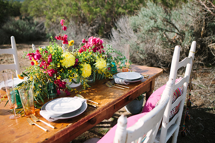 Anza-valley-wedding-at-the-alpaca-farm-brown-wood-table-with-white-place-settings-and-flower-decor.jpg