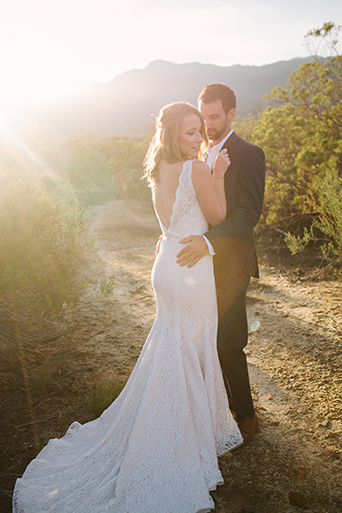 Anza-valley-wedding-at-the-alpaca-farm-groom-hugging-bride-at-sunset.jpg