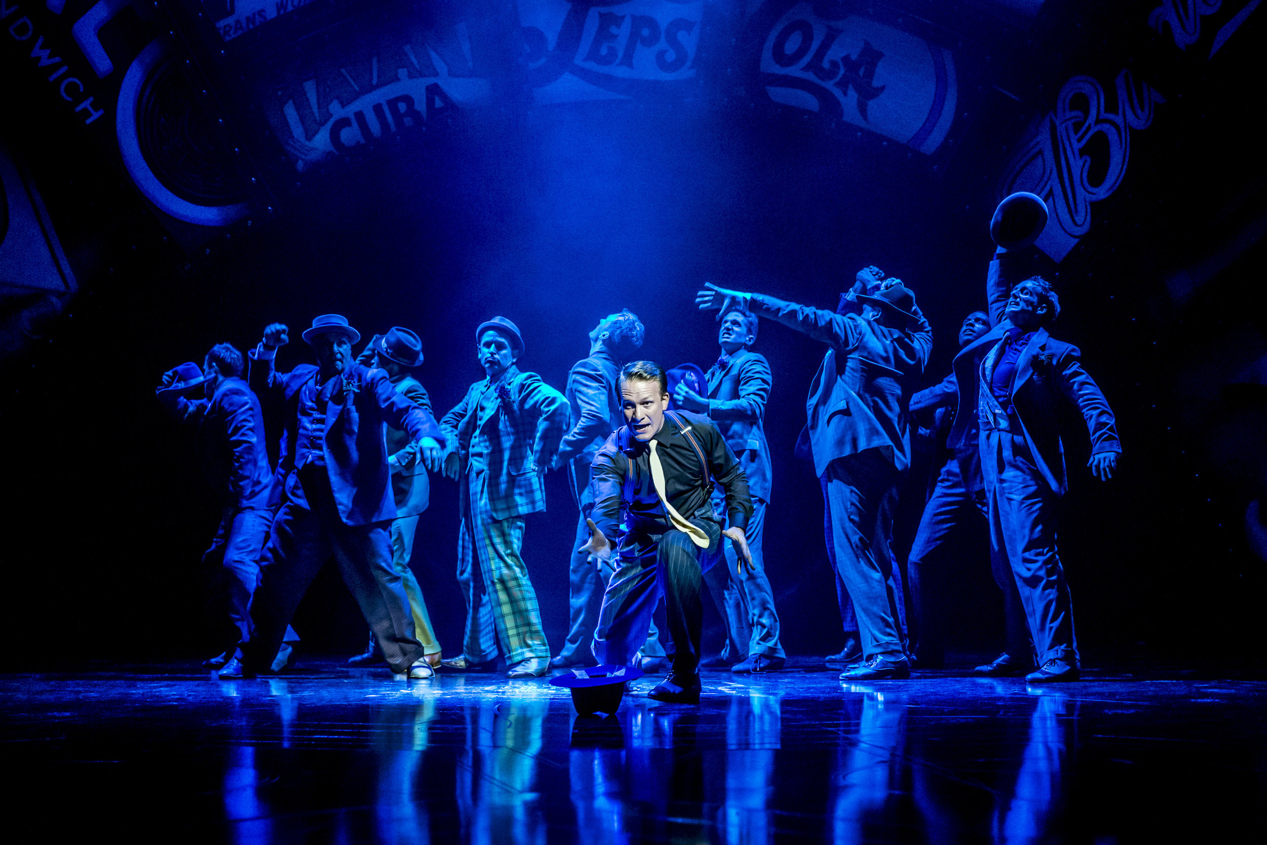 1. CFTguysdolls05966-Jamie Parker (Sky Masterson) foreground, with Guys and Dolls Company. Photo Johan Persson.jpg