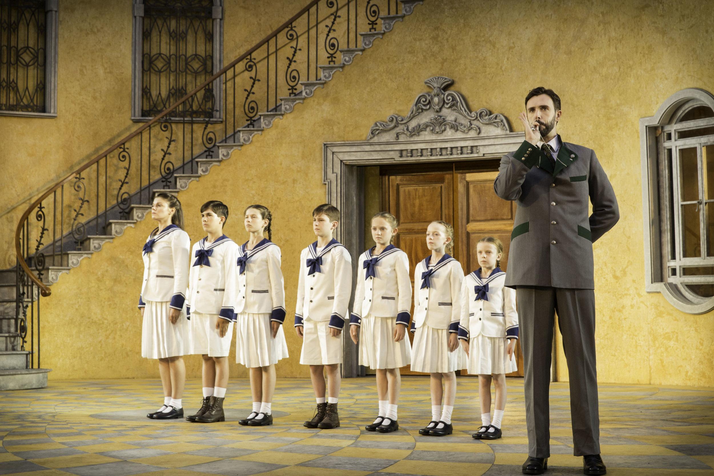5. Michael Xavier as Captain von Trapp and the children. Photo Johan Persson.jpg